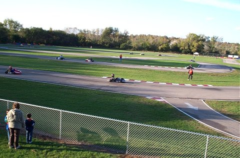 Watching the wheel-to-wheel racers and dreaming of their turn...